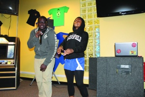 Michael Ogundare, a junior, sang a Boys II Men song along with the help of Erica Hawkins, a senior, at the Poetry Slam/Open Mic Night at The Roost on Feb. 20. (Lexi Philippi/ The Runner)
