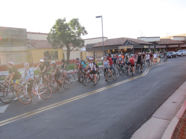 A group of cyclists line up at Town and Country Village to start their route for the Ride of Silence on May 15. (Tara Baraceros/The Runner).