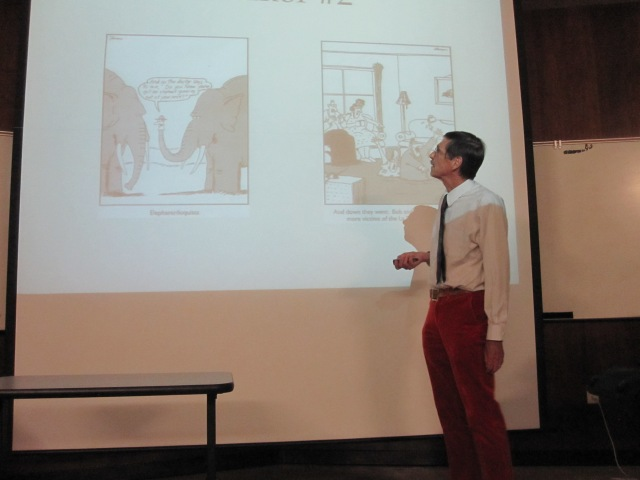 Dr. Russel Schuh talks about cartoons with puns to a CSUB audience on May 15 in the BDC. (Tara Baraceros/The Runner).