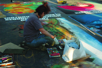 Photos by Tara Baraceros/The Runner Artists work to finish their chalk and pastel art pieces at