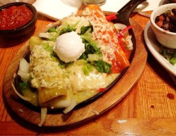 Image by Autumn Parry/The Bakersfield Californian Camino Real's sizzling enchiladas are a treat.