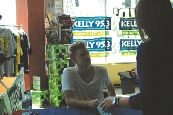 Photos by Elyse Riva/The Runners Cody Simpson signing autographs after a private show at FYE on Sunday October 13, 2013.