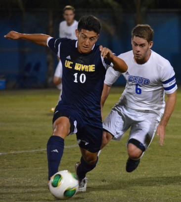 Scott Luedtke defends and oncoming Irvine player in the 'Runners' 3-0 loss on Saturday, Sept. 28.