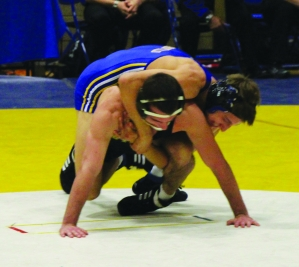 Tara Baraceros/ The Runner CSUB's Kyle Anderson, redshirt freshmen, wrestles against a Appalachian State.