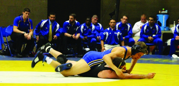 Tara Baraceros/ The Runner Appalachian State wrestles against Kyle Anderson, CSUB's redshirt freshmen wrestler.