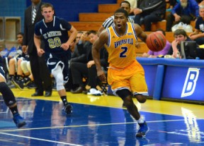 Abi Khan/The Runner Junior guard Tyrell Corbin drives the ball to the hoop in Monday's 97-54 win over UC Merced. Corbin finished the game with 12 points.