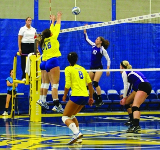 Juana Martinez/The Runner Junior blocker Molly O'Hagan and senior blocker Julia Bowen made a perfect block against Grand Canyon University on Saturday, Nov. 9.