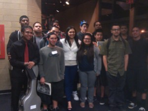 Iren Arutyunyan joins students who participated in Guitar Day 2014 after her concert for a picture.
