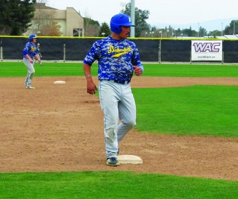 Senior shortstop Oscar Sanay stops at third base during practice on Friday, Jan. 24. Sanay led the 'Runners in most offensive statistics last season and looks to lead the team to a repeat of last year's great conference success.