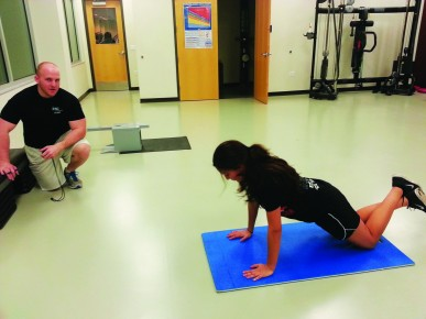 Trainer Josh Thompson oversees his client Marisol Escudero, working hard to reach her goals at the Student Recreation Center on Jan. 16.