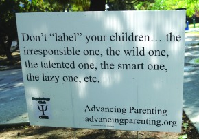 Advancing Parenting signs cross the line