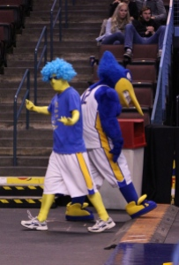 """Diana Olivares/The Runner Jordan Lovett, the CSUB """"Superfan"""" dances past the 'Runners mascot Rowdy as he roots on the men's basketball team on March 1 at Rabobank Arena"""