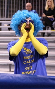 """Diana Olivares/The Runner Jordan Lovett, the CSUB """"Superfan"""", cheers on the men's basketball team on March 1 in his yellow bodysuit and blue wig."""