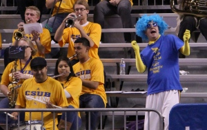 "Diana Olivares/The Runner Jordan Lovett, the CSUB ""Superfan"" dances with the CSUB pep band at a 'Runners men's basketball game on March 1 at Rabobank Arena"