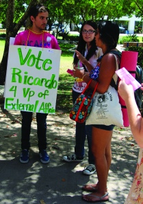 Crismat Mateo/The Runner Ricardo Perez, vice president of external affairs, walks around campus with posters and talks to his schoolmates to encourage them to vote for him on Thursday, May 15.