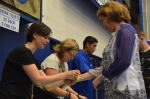 Eric Garza/The Runner Volunteer Eric Ueberroth gives Maureen Rush, from the CSUB math department, her drink wristband.