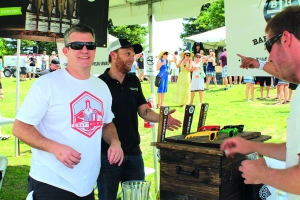 Layne Ogle/The Runner Chris Vaughn (right), co-founder of Barrel House Brewing Company, enjoys volunteering at the Craft Beer Festival on Saturday, May 24.