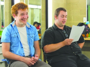 Bre Williams/The Runner Freshman theater major Kyle Gaines laughed as Alexander Helland, a senior English major, read a comedic role in one of the club's student-wrote screenplays on May 16.
