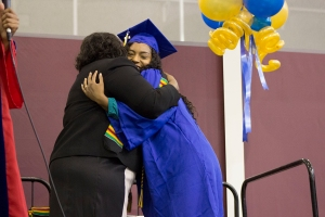 Adriana Vega/The Runner Graduating Senior Linda Forrester and Karla Young, embrace after Young awarded Forrester with her Kente Stole at the Black Graduates Recognition Ceremony, May 31.