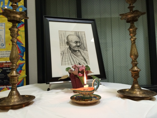 Stephanie Viloria / The Runner A picture of Mahatma Gandhi is displayed in front of the Multi-Purpose Room at CSUB for the Seventeenth Annual Bakersfield Interfaith Conference on Sept. 27.